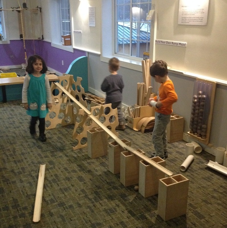 Children play with their wooden Rigamajig building creation