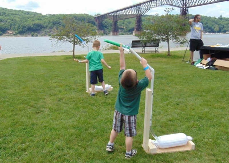 Children shooting foam rockets near the Hudson River