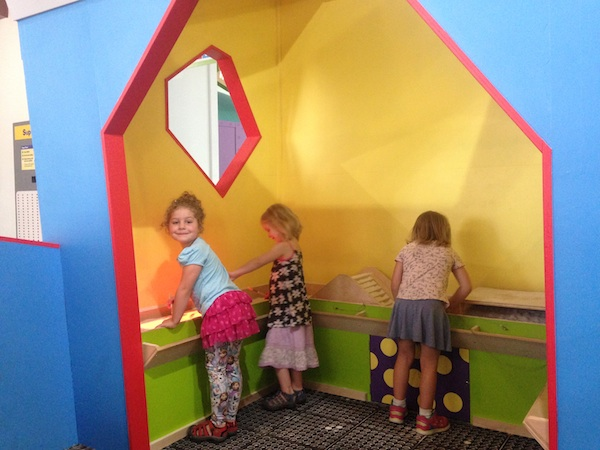 Children playing in The Storybox Exhibit