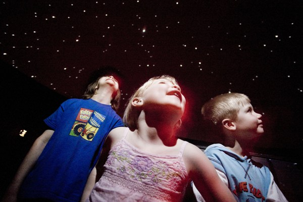 Children looking up inside our StarLab Planetarium