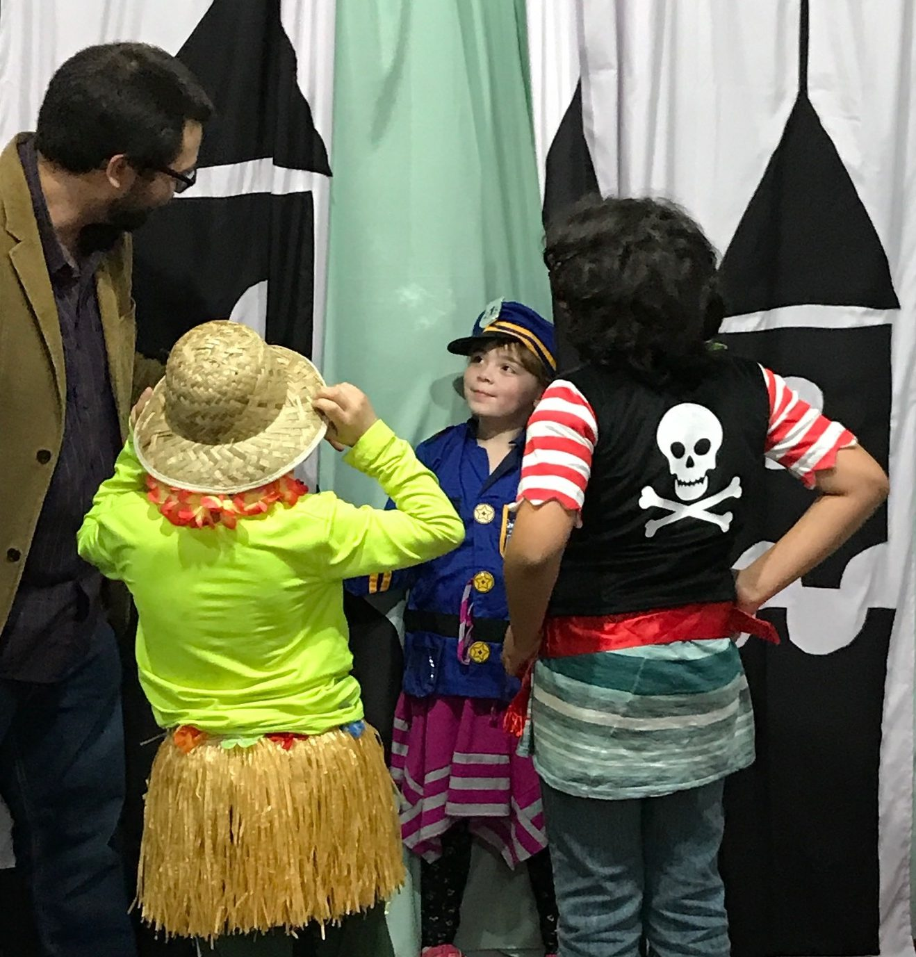 Children in costume with educator