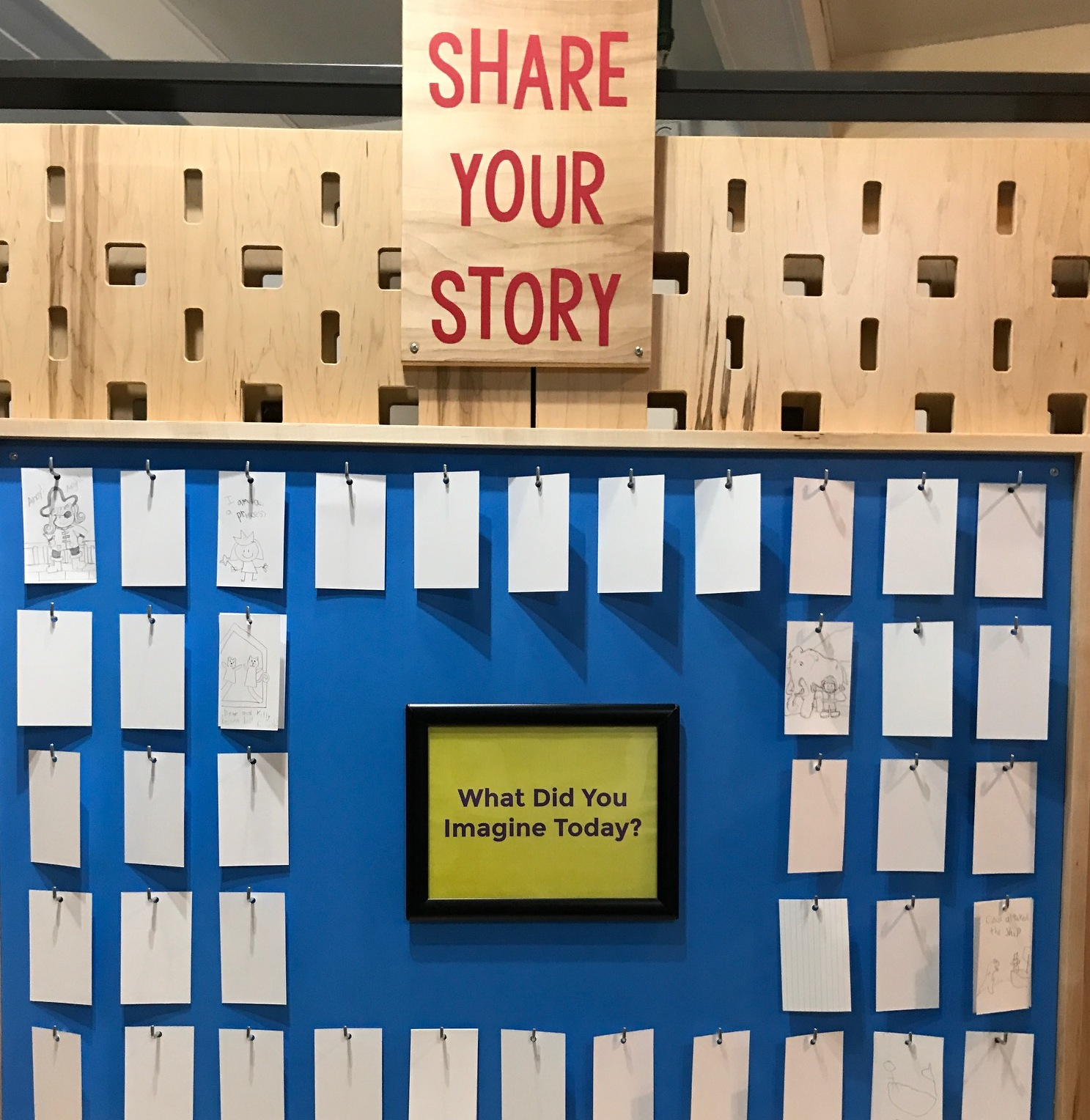 Share Your Story exhibit with sign asking: What Did You Imagine Today?