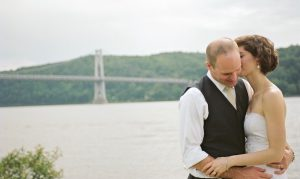 Wedding couple on shore of Hudson River