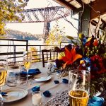Formal table setting overlooking waterfront