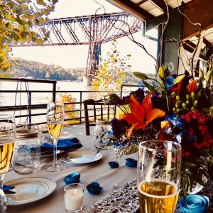 Formal table setting with Hudson River in background